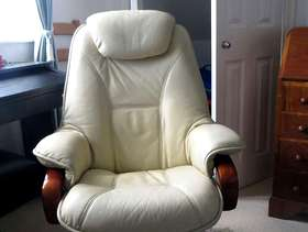 Freecycle 2 cream leather easy chairs with matching footstools