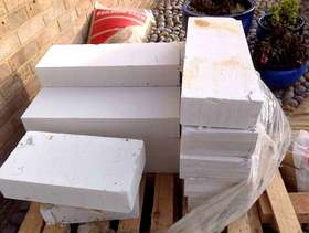 Freecycle 28 bricks, 13 building blocks 21X60X10cm, 4.1/2 bags builders sand.