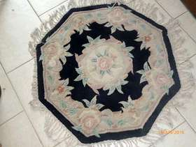 Freecycle Octagonal Chinese style rug.
