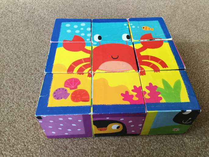 FreelyWheely: Animal block puzzle with small book for babies