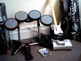 Freecycle Xbox 360, kinnect, drum kit guitar, beatles guitar +7 games