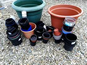 Freecycle Stack of large and small plastic plant pots