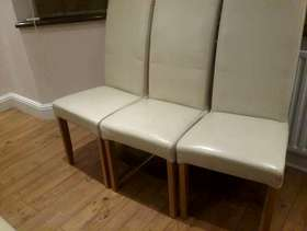 Freecycle Six cream faux leather chairs