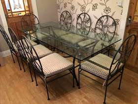 Freecycle Ornate wrought iron glass topped table with eight chairs
